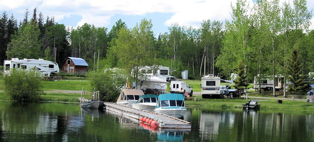 lake-dock-with-motor-boats-and-RV-parks-in-background.jpg